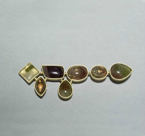 Broche oro 750 cuarzo con inclusion de turmalina turmalinas